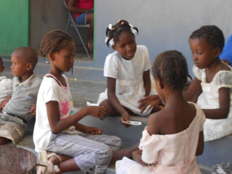 C children playing cards